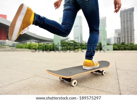 speeding skateboarding woman at city  - stock photo