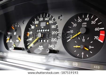 Speedometer and tachometer gauges - stock photo