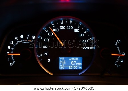 Speedometer of a car illuminated - stock photo