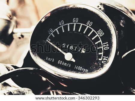 speedometer of vintage motorcycle with retro filter - stock photo