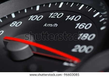 Speedometer passenger car, showing a higher speed. - stock photo