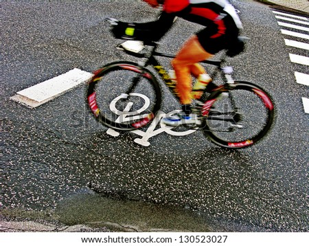Speedy cyclist. - stock photo