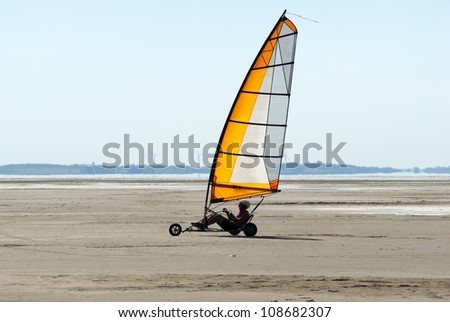 Speedy landsailing a summer day on beach - stock photo