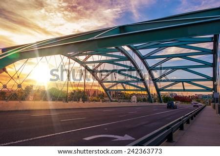 Speer Boulevard Bridge at Sunset. Bridge Traffic. City of Denver, United States. - stock photo