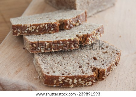 Spelled bread on sourdough. Healthy, whole grain with sunflower, sesame and linseed. It contains no artificial additives, dyes, or preservatives. - stock photo