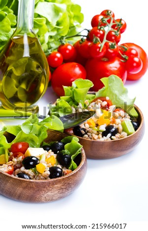 spelt salad with tomatoes and olives on white background - stock photo