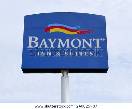 SPENCER , WISCONSIN, Dec,26,2014,  Baymont Inn and Suites Highway sign. Baymont Inn and Suites is a Hotel franchise that was started in 1973 in Oshkosh Wisconsin. - stock photo