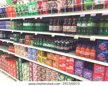 SPENCER , WISCONSIN, March,24, 2016    Several brands of soda on display in a modern American grocery store - stock photo
