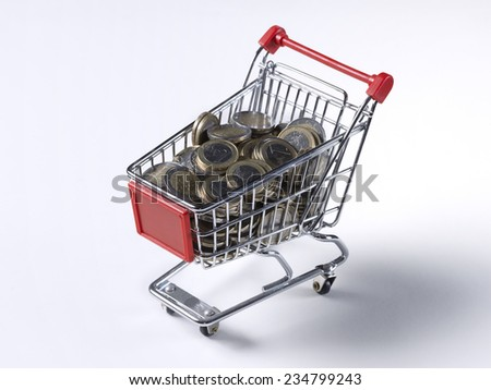 Spending Coins from Cart - stock photo