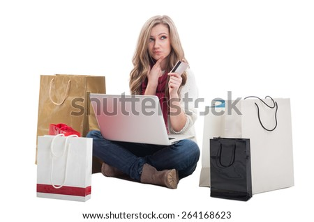 Spending money online using credit or debit card concept with a woman holding a laptop ready to spend money on e-shops - stock photo