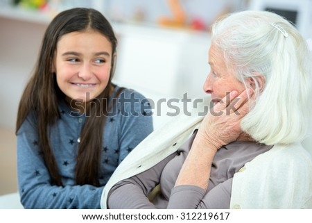 Spending time with grandma - stock photo