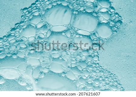 Spheric bubbles extreme closeup. - stock photo