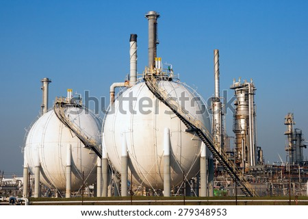 Spherical gas tank farm in a petroleum refinery. - stock photo