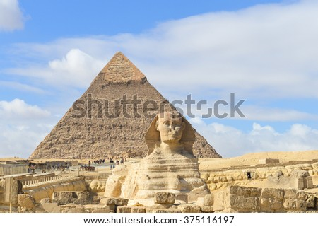 Sphinx and Giza Pyramids in Cairo, Egypt - stock photo