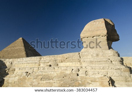 Sphinx and Great pyramid of Giza in Egypt. Gods of Egypt in stone and bricks - stock photo