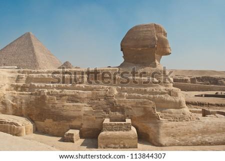 sphinx and pyramid - stock photo