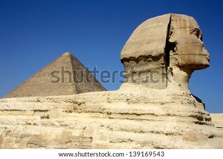 Sphinx and Pyramid Mid-Shot, Giza, Cairo, Egypt - stock photo