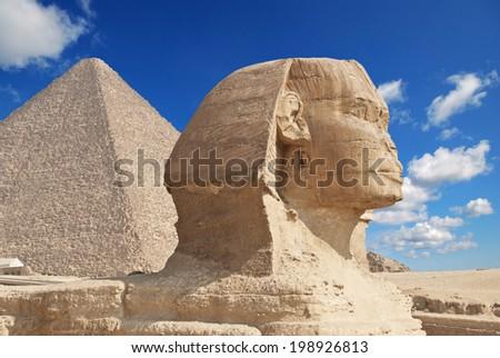 sphinx and pyramids in giza  - stock photo