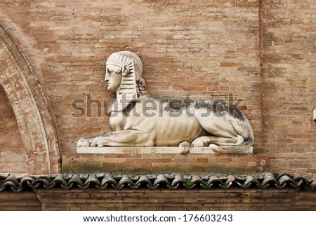 Sphinx statue in a renaissance building in Urbino, Italy - stock photo