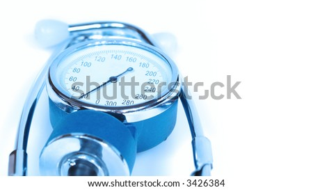 sphygmomanometer in blue lights - blood pressure measure - stock photo