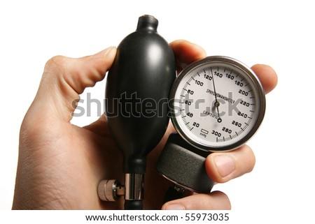 sphygmomanometer in hand - stock photo