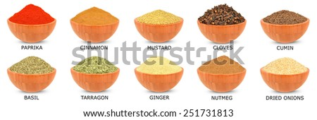 spice in a wooden bowl isolated on white - stock photo