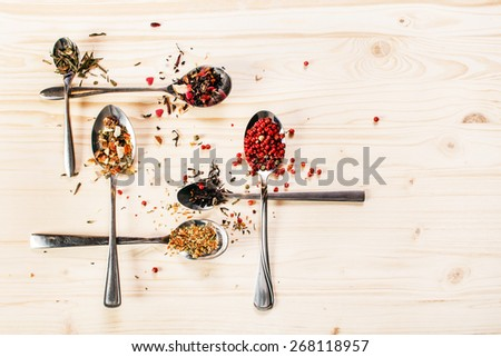 spice on the spoons - stock photo