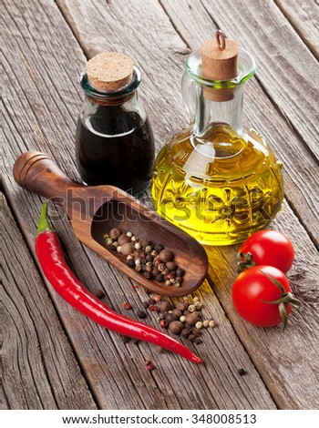 Spices and condiments on wooden table - stock photo
