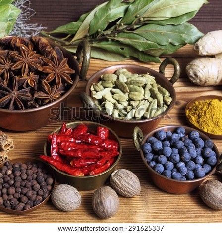 Spices and herbs in metal  bowls. Food and cuisine ingredients. Colorful natural additives. - stock photo
