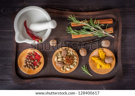 Spices and herbs on an old tray - stock photo