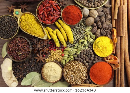Spices and herbs on wooden background. Food and cuisine ingredients. - stock photo
