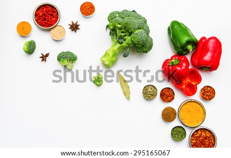 Spices and vegetables for cooking and health on background. - stock photo
