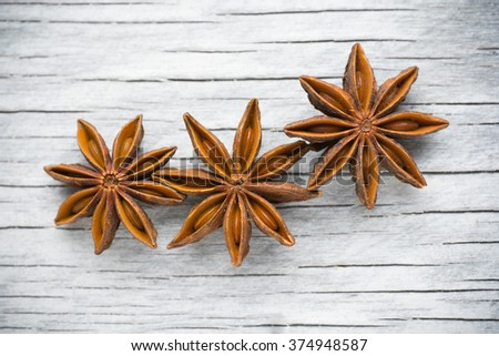 Spices. Anise stars on the vintage wooden background  - stock photo