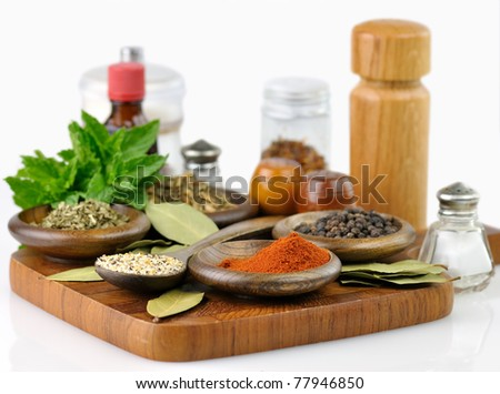 spices arrangement on a wooden board , close up - stock photo