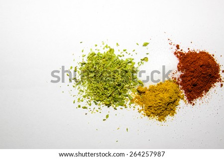 spices colorful  oregano salt  curry and rose paprika  - stock photo