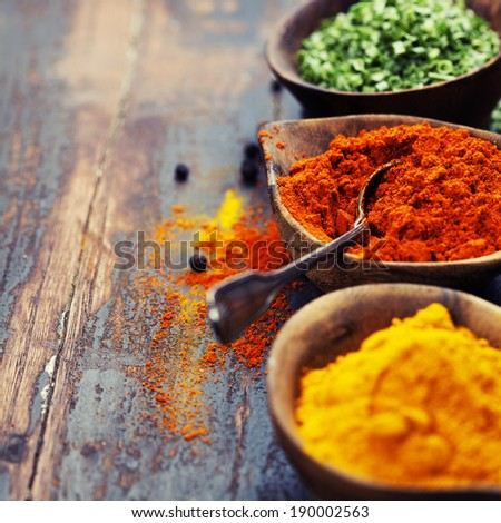 Spices Curry, Paprika, Dry Chives. Spices and herbs over Wood - stock photo
