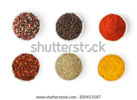 Spices in a bowls isolated on white background, top view - stock photo