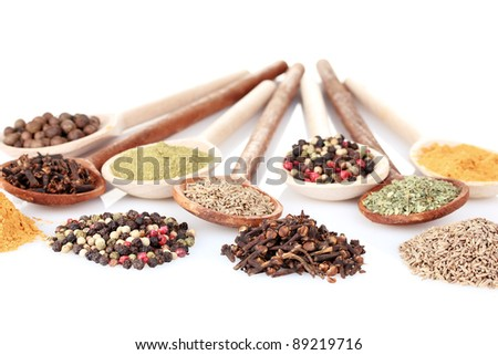 spices in the spoons isolated on white - stock photo