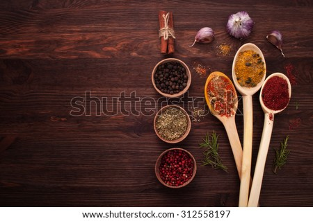 Spices of the world; spices in a wooden spoon; the substrate for the menu bars and restaurants; Cover cookbook; recipes; spicy food; Mexican cuisine; Georgian cuisine - stock photo