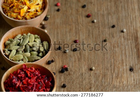 Spices on the wooden table with copy-space - stock photo
