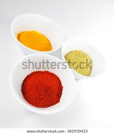 Spices on white. Curry or cumin, paprika powder and chili powder        - stock photo
