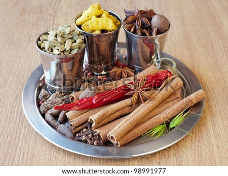 Spices: pepper, nutmeg, cinnamon, cloves, cardamom, turmeric, star anise - stock photo