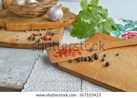 spices: saffron, peppercorn, garlic, Bay leaf, mustard greens. - stock photo