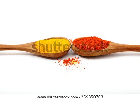 Spices. Spice in Wooden spoon. Herbs. Curry, turmeric, red chili powder isolated on a white background - stock photo