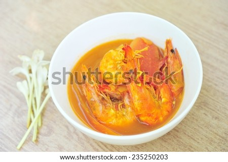 Spicy and sour soup whit shrimp and vegetables (kang-som-koong),Thai food. - stock photo
