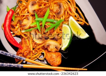 Spicy asian noodles with mushrooms and chicken - stock photo