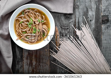 Spicy asian soup with soba noodles - stock photo