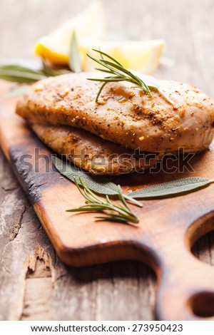 Spicy baked chicken breast with rosemary - stock photo