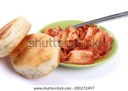 Spicy cabbage, scones on white background - stock photo