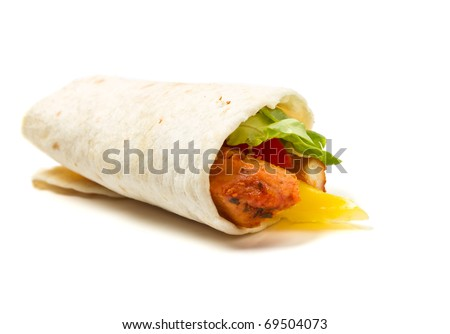 Spicy chicken with salad and salsa wrapped in a soft flour tortilla. - stock photo